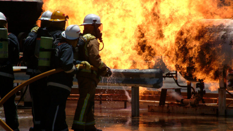 34789717 - huge flames as gas leak catches fire and burns out of control with fire crews trying to dampen flames